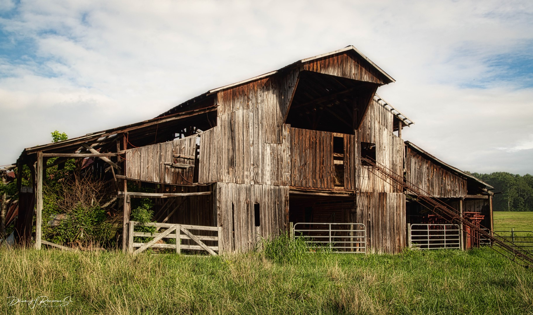 This old barn is about to collaspe into itself.